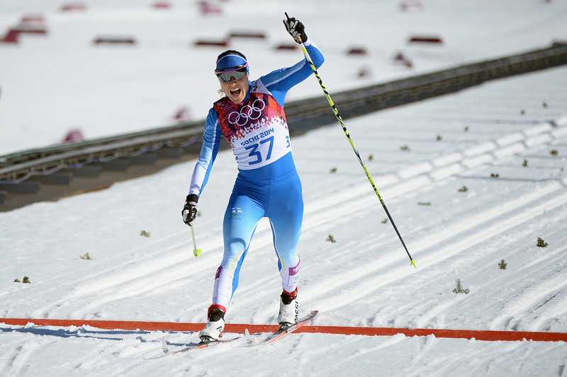 . Aino-Kaisa Saarinen of Finland crosses the finish line in the Women\'s 10 km Classic during day six of the Sochi 2014 Winter Olympics at Laura Cross-country Ski & Biathlon Center on February 13, 2014 in Sochi, Russia.  (Photo by Harry How/Getty Images)