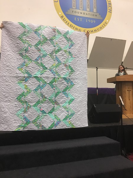 Peg Largo showing us a quilt that was just returned to her by Nancy Boyse.  Peg made the top.