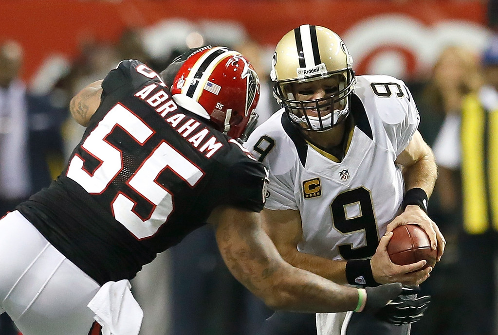 . ATLANTA, GA - NOVEMBER 29:  John Abraham #55 of the Atlanta Falcons sacks Drew Brees #9 of the New Orleans Saints at Georgia Dome on November 29, 2012 in Atlanta, Georgia.  (Photo by Kevin C. Cox/Getty Images)