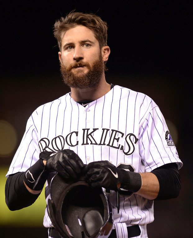 . DENVER, CO - MAY 15: Charlie Blackmon adjusted his batting helmet after he got on base. The Colorado Rockies hosted the San Diego Padres at Coors Field  Friday night, May 16, 2014. (Photo by Karl Gehring/The Denver Post)