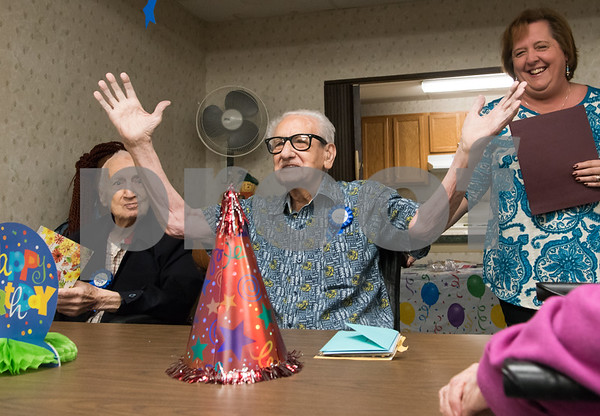 11/14/17 Wesley Bunnell | Staff Jerry DeVito, age 100, celebrated his birthday along with Leon Hatoff, age 104, at Franklin Square Manor on Tuesday afternoon. DeVito raises his arms to say think you to guests as Hatoff, L, and Property Manager Bonny Boehnert look on.