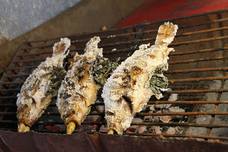 Stuffed with whole lemon grass and coated in salt on a small grill.  I bet this was moist and delicious