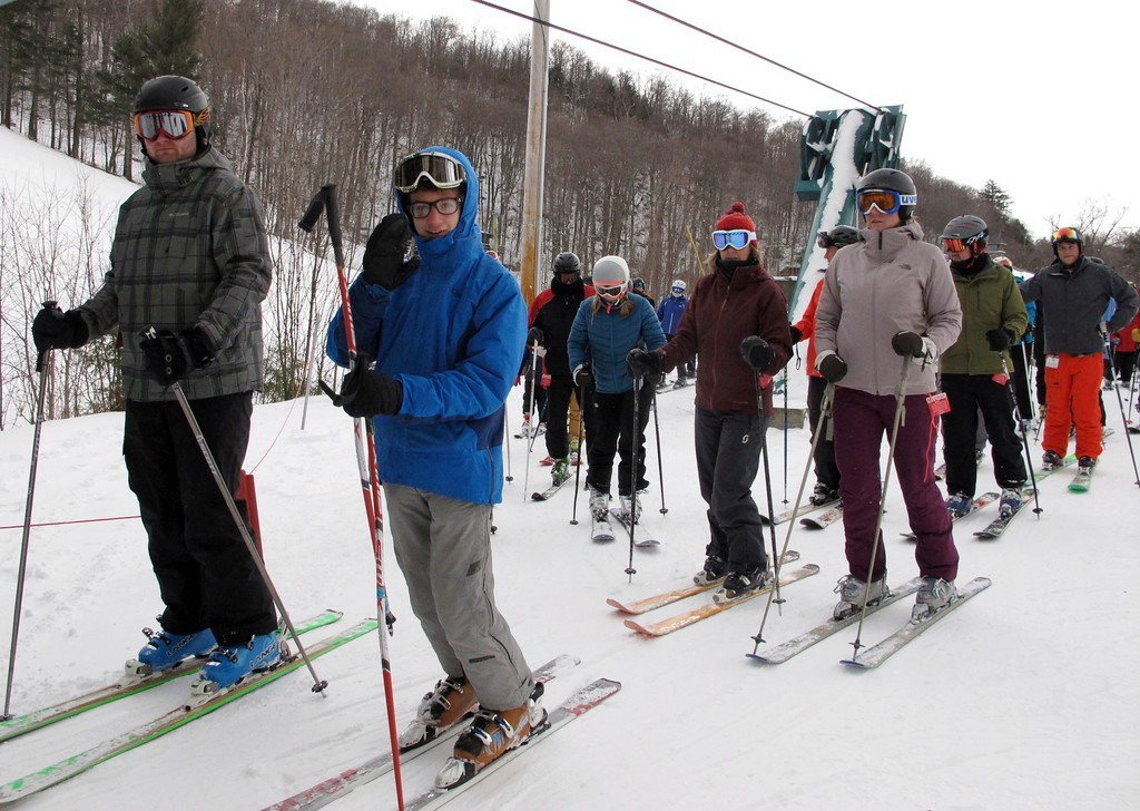 . In this Dec. 30, 2016 photo, skiers stand in a lift line at Mad River Glen in Fayston, Vt. Northeast ski areas are relishing the new snow from a nor\'easter that dumped as much as 20 inches in Maine, following a dismal season last winter with little natural snow. (AP Photo/Lisa Rathke)