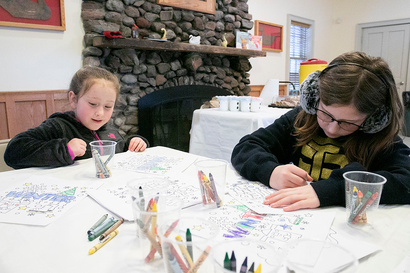 Coloring Saturday, Feb. 1, 2020 at Winterfest held at Coggshall Park in Fitchburg is Madelyn Couture, 5, and her sister Hannah, 11, from Fitchburg. SENTINEL & ENTERPRISE/JOHN LOVE