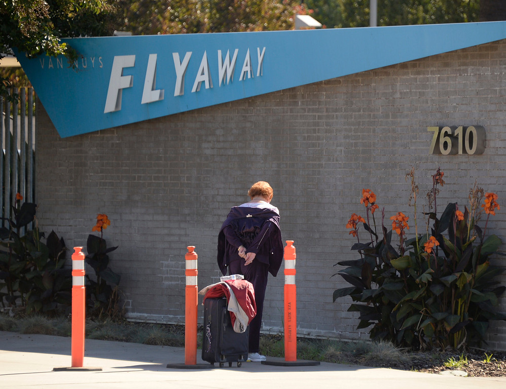. The popular Flyaway bus system to LAX was shutdown at 9:30am after the shooting at LAX that killed one TSA agent. Travelers who were on the busses on the way to LAX were stuck and turn back to Van Nuys airport. Other travelers arriving at the Flyaway during the shutdown were turn away being that no buses were running till further notice. Nov 1 ,2013. photo by Gene Blevins/LA Daily News