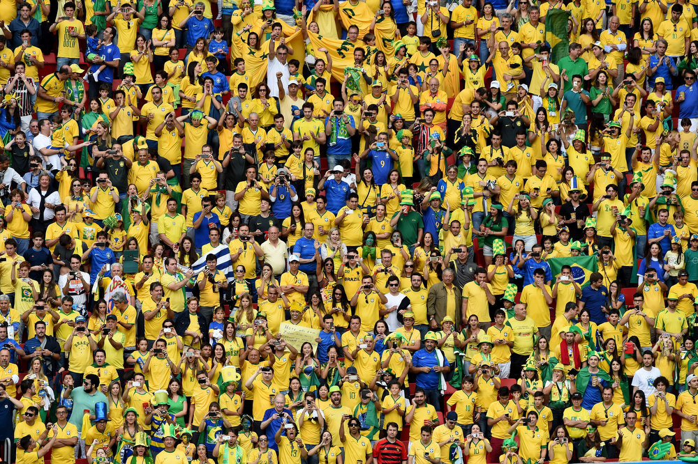 . Brazil\'s fans cheer prior to the Group A football match between Cameroon and Brazil at the Mane Garrincha National Stadium in Brasilia during the 2014 FIFA World Cup in Brazil on June 23, 2014.  AFP PHOTO / EVARISTO SAEVARISTO SA/AFP/Getty Images