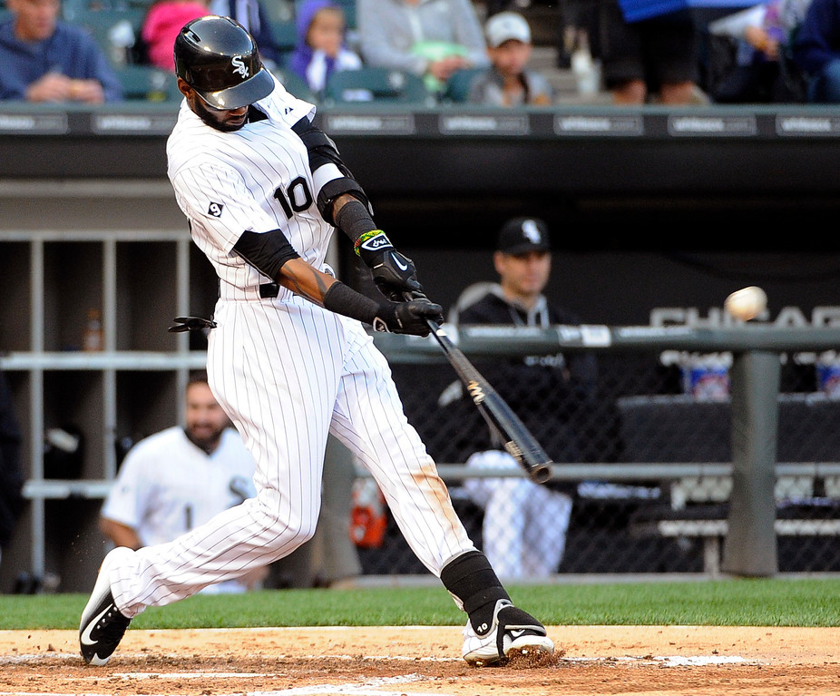 . Chicago White Sox\'s Alexei Ramirez (10) hits an RBI double against the Detroit Tigers during the third inning of a baseball game, Saturday, June 6, 2015 in Chicago.  (AP Photo/David Banks)