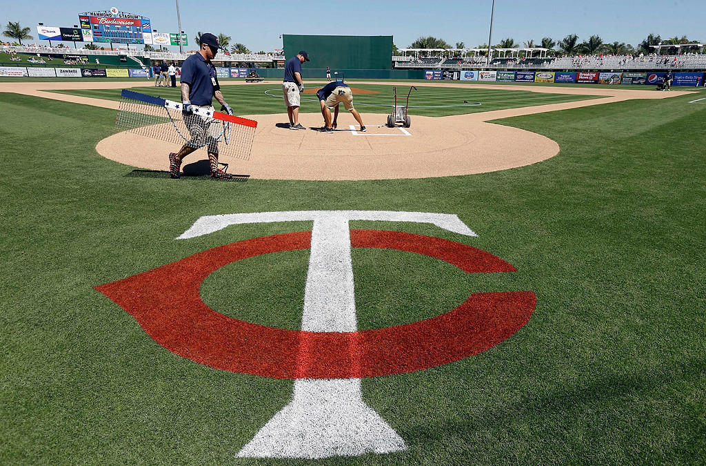 . Grounds crew prepare the batters box before an exhibition baseball game between the Boston Red Sox and the Minnesota Twins, Saturday, March 1, 2014, in Fort Myers, Fla. (AP Photo/Steven Senne)
