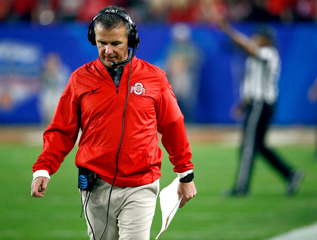 . Ohio State coach Urban Meyer talks via his headset during the first half of the Fiesta Bowl NCAA college football playoff semifinal against Clemson, Saturday, Dec. 31, 2016, in Glendale, Ariz. (AP Photo/Ross D. Franklin)