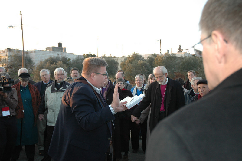 Scott Weidler, ELCA Worship and Liturgical Resources staff, leads singing at the Israeli separation barrier Jan. 12 at Beddo, West Bank.