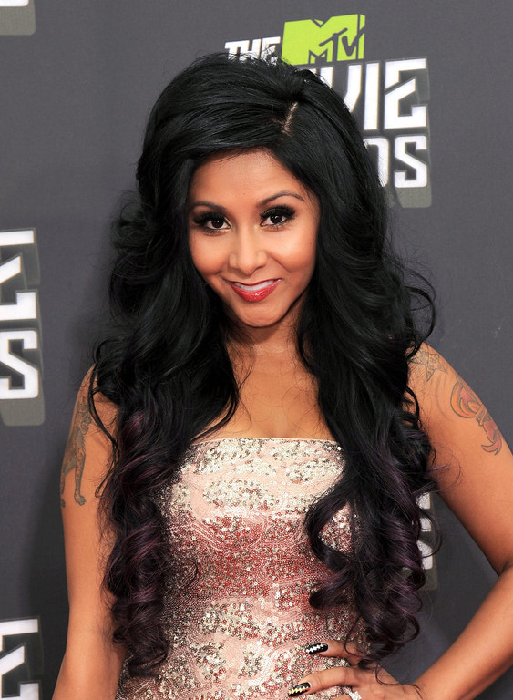 """. Nicole \""""Snooki\"""" Polizzi arrives at the MTV Movie Awards in Sony Pictures Studio Lot in Culver City, Calif., on Sunday April 14, 2013. (Photo by Jordan Strauss/Invision/AP)"""
