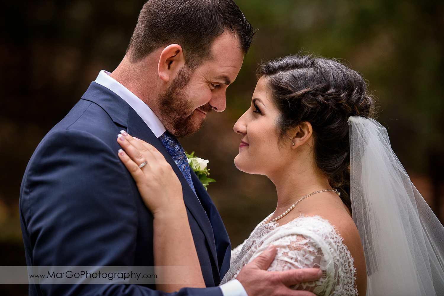 portrait of bride and groom looking at each other at Saratoga Springs Cathedral Grove
