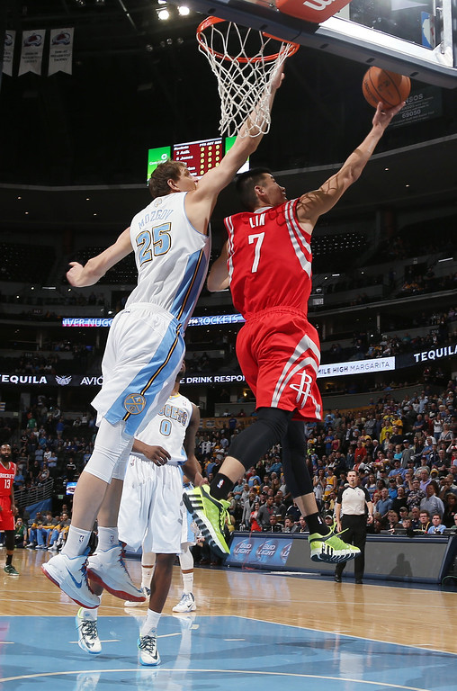 . Houston Rockets guard Jeremy Lin, right, goes up for shot as Denver Nuggets center Timofey Mozgov, of Russia, covers in the first quarter of an NBA basketball game in Denver on Wednesday, April 9, 2014. (AP Photo/David Zalubowski)