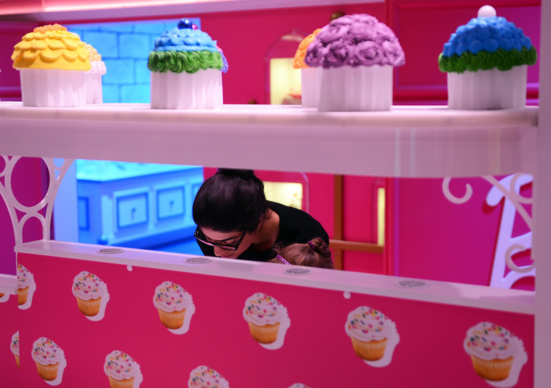 . The pink kitchen is pictured with cupcakes in the Barbie Dreamhouse Experience near Alexanderplatz square  in Berlin, Germany, Thursday May 16,  2013. The 2,500 square meter Barbie Dreamhouse Experience will be open for three months in Berlin.  (AP Photo/dpa, Jens Kalaene)