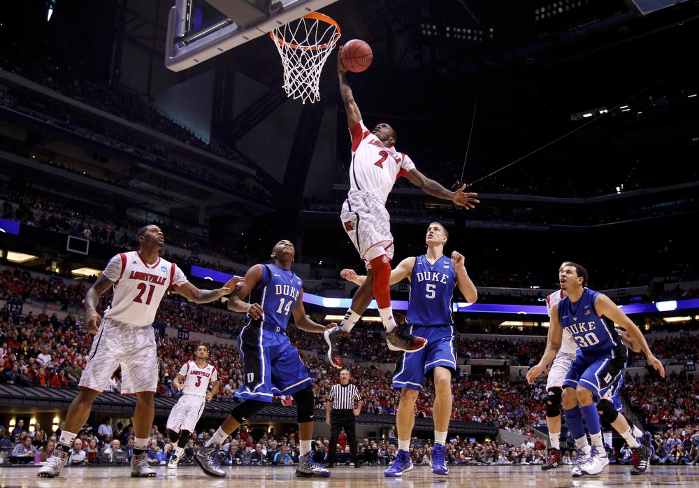 Description of . Louisville Cardinals guard Russ Smith (2) goes to the basket to score in the first half against the Duke Blue Devils during their Midwest Regional NCAA men's basketball game in Indianapolis, Indiana, March 31, 2013. REUTERS/Jeff Haynes
