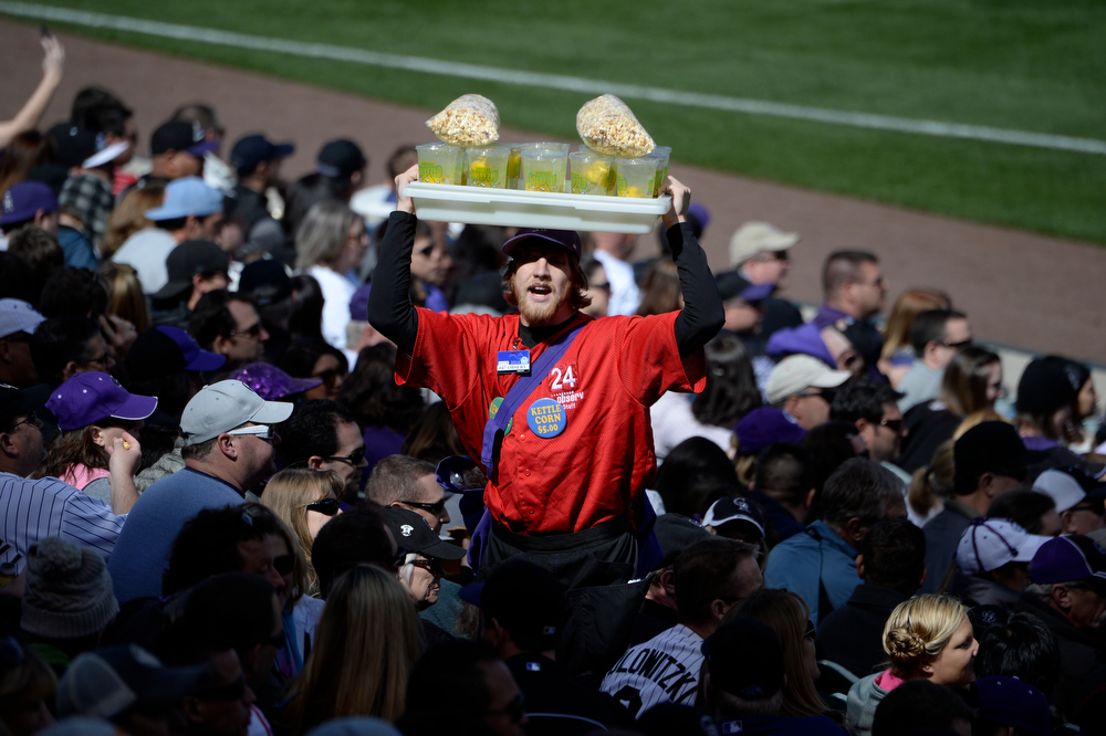 . A vendor sells kettle corn during the Colorado Rockies home opener against the Arizona Diamondbacks at Coors Field in Denver, CO April 04, 2014. (Photo By Craig F. Walker / The Denver Post)