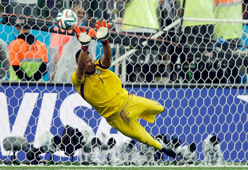 . Argentina\'s goalkeeper Sergio Romero deflects a shot from the penalty spot by Netherlands\' Wesley Sneijder during the World Cup semifinal soccer match between the Netherlands and Argentina at the Itaquerao Stadium in Sao Paulo, Brazil, Wednesday, July 9, 2014. Argentina beat the Netherlands 4-2 in a penalty shootout to reach the World Cup final. (AP Photo/Frank Augstein)