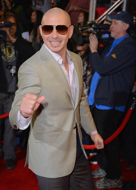 ". Singer Pitbull arrives at Fox\'s ""The X Factor\"" Season Finale - Night 2 at CBS Televison City on December 20, 2012 in Los Angeles, California.  (Photo by Frazer Harrison/Getty Images)"