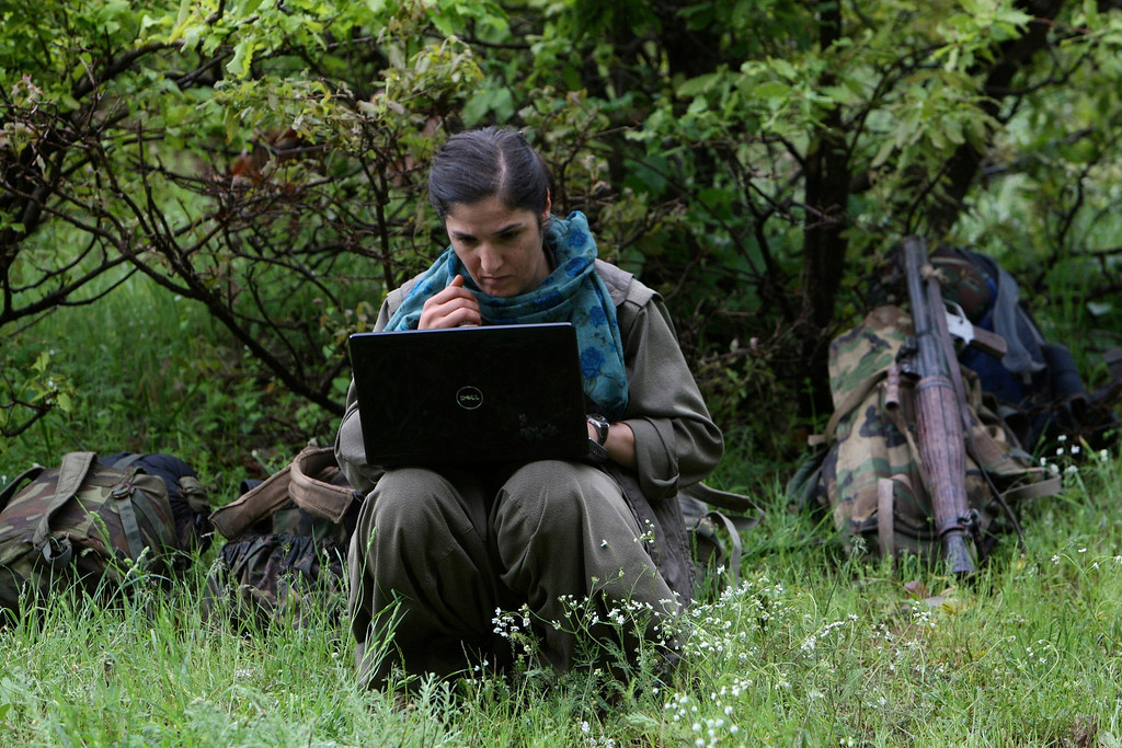 . A member of Kurdistan Workers Party (PKK) works on her laptop in northern Iraq May 14, 2013. The first group of Kurdish militants to withdraw from Turkey under a peace process entered northern Iraq on Tuesday, and were greeted by comrades from the Kurdistan Workers Party (PKK), in a symbolic step towards ending a three-decades-old insurgency. The 13 men and women, carrying guns and with rucksacks on their backs, arrived in the area of Heror, near Metina mountain on the Turkish-Iraqi border, a Reuters witness said. REUTERS/Azad Lashkari