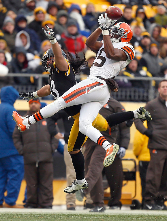 . Cleveland Browns wide receiver Greg Little (15) cannot make a catch as Pittsburgh Steelers strong safety Troy Polamalu (43) defends in the fourth quarter of an NFL football game in Pittsburgh, Sunday, Dec. 30, 2012. The Steelers won 24-10. (AP Photo/Gene J. Puskar)