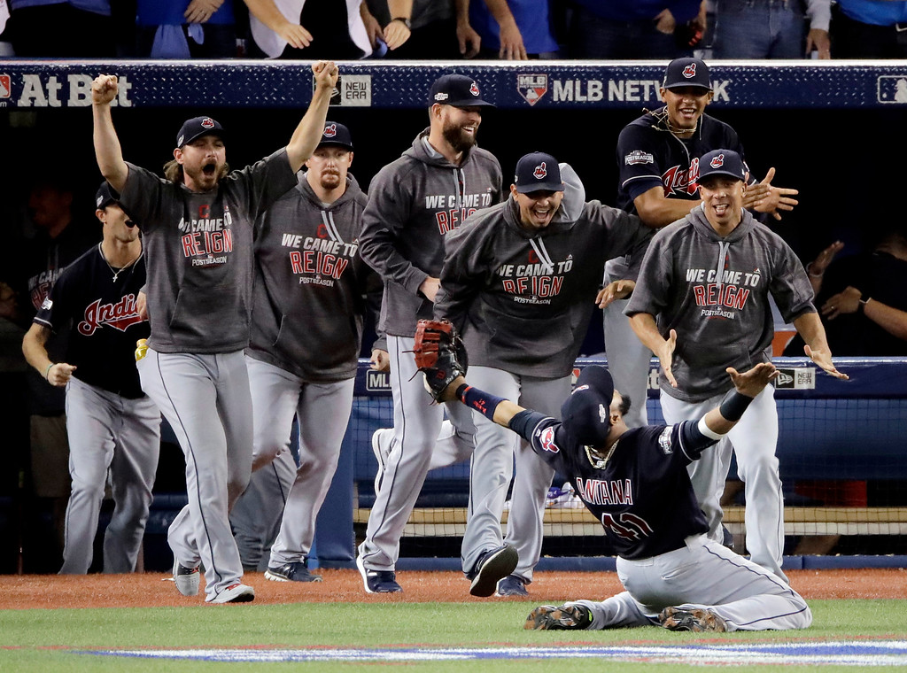 . FILE - In this Wednesday, Oct. 19, 2016, file photo, Cleveland Indians first baseman Carlos Santana celebrates after making the final out in their 3-0 win over the Toronto Blue Jays in Game 5 of baseball\'s American League Championship Series in Toronto. Four months after LeBron James and the Cavaliers ended the city�s championship drought at 52 years by winning the NBA title, the Indians are back in the World Series for the first time since 1997.  (AP Photo/Charlie Riedel, File)