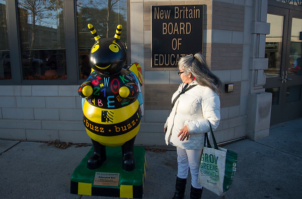 11/06/19 Wesley Bunnell | StaffrrEvelyn Vargas looks over the Educated Bee statue painted by artist Whitney Weldon outside of the New Britain Board of Education on Wednesday November 6.