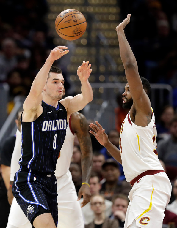 . Orlando Magic\'s Mario Hezonja (8), from Croatia, passes over Cleveland Cavaliers\' Tristan Thompson (13) in the first half of an NBA basketball game, Thursday, Jan. 18, 2018, in Cleveland. (AP Photo/Tony Dejak)