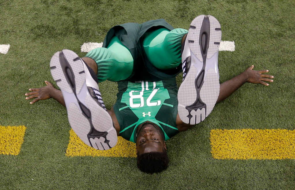 . Memphis defensive lineman Martin Ifedi is measured for flexibility at the NFL football scouting combine in Indianapolis, Sunday, Feb. 22, 2015. (AP Photo/David J. Phillip)