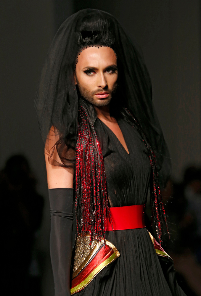 . Austrian singer and Eurovision Song Contest winner Conchita Wurst wears a creation as part of the Jean-Paul Gaultier Fall Winter 2014-15 Haute Couture fashion collection, presented in Paris, Wednesday, July 9, 2014. (AP Photo/Jacques Brinon)