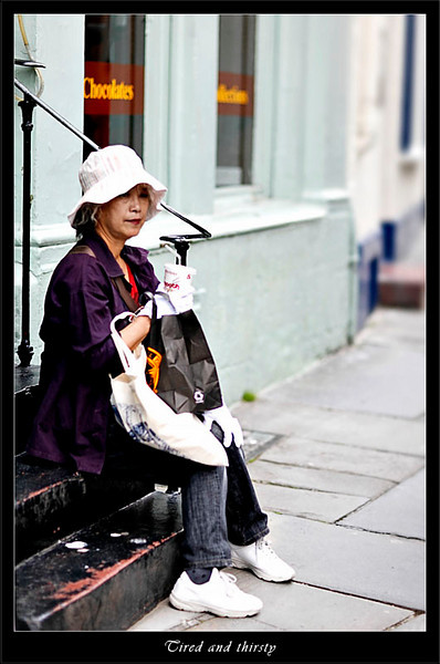 Tourist waiting outside Bath Spa looking tired and thirsty (80357281).jpg