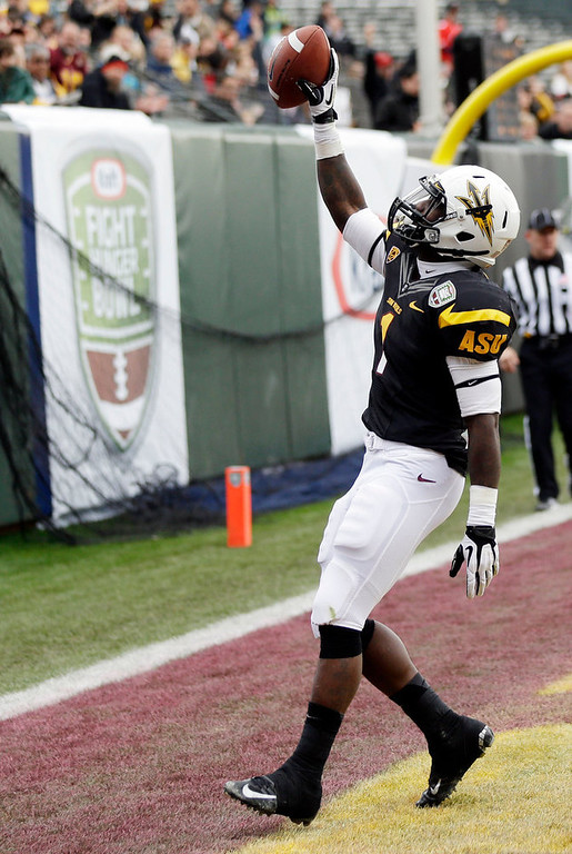 . Arizona State running back Marion Grice, celebrates his 10-yard touchdown run against Navy during the first half of the Fight Hunger Bowl NCAA college football game in San Francisco, Saturday, Dec. 29, 2012. (AP Photo/Marcio Jose Sanchez)