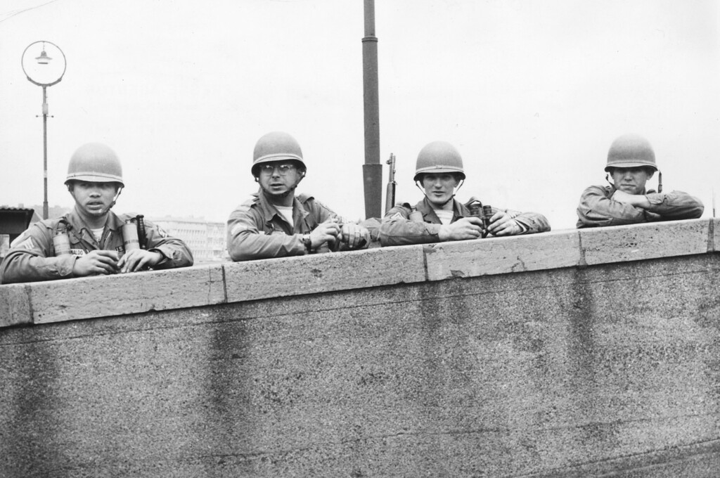 . American soldiers stationed in West Berlin keeping watch over the Berlin Wall, circa 1965.  (Photo by Three Lions/Getty Images)