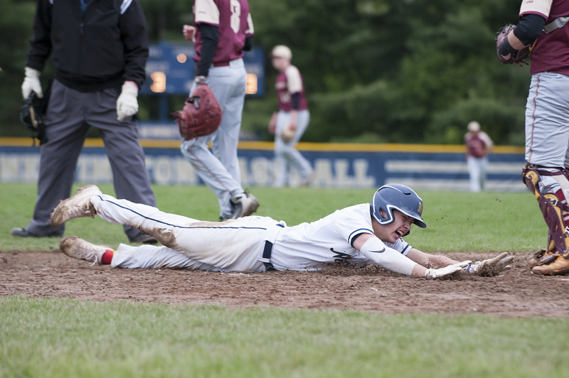 05/14/19  Wesley Bunnell | Staff  Newington baseball defeated New Britain 4-3 in a walk off on Tuesday afternoon at Newington High School. Newington's Gunnar Johnson (5) slides safely into home on a walk off win.