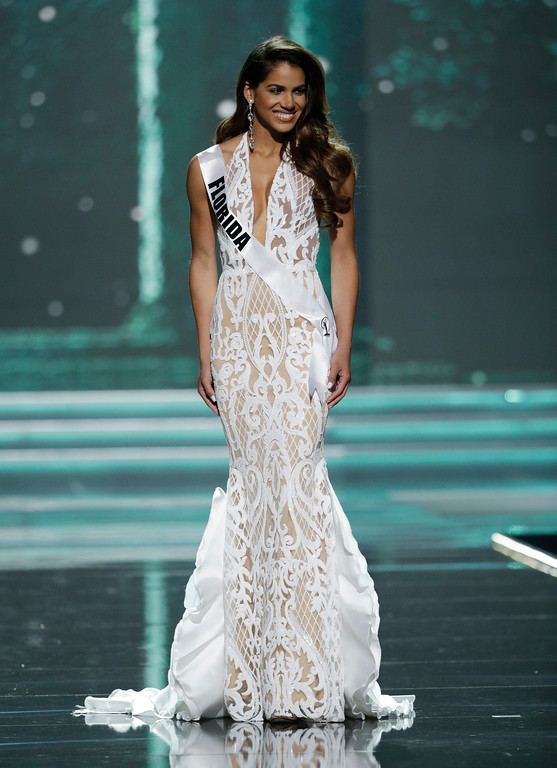 . In this May 11, 2017, photo, Miss Florida USA Linette De Los Santos competes during a preliminary competition for Miss USA in Las Vegas. De Los Santos was born in Santo Domingo, Dominican Republic and was raised in Miami, Florida. Five of the contestants vying for the Miss USA title this year were born in other countries and now U.S. citizens. (AP Photo/John Locher)