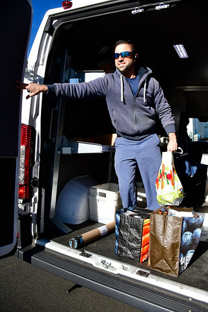 11/23/2019 Mike Orazzi | Staff Bristol postal worker Chris Bachand while collecting food and delivery mail on Edgewood Street in Bristol on Saturday.
