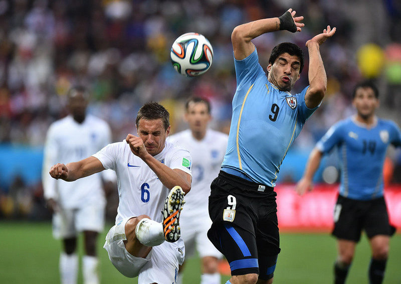. England\'s defender Phil Jagielka (L) kicks the ball past Uruguay\'s forward Luis Suarez during the Group D football match between Uruguay and England at the Corinthians Arena in Sao Paulo on June 19, 2014, during the 2014 FIFA World Cup. BEN STANSALL/AFP/Getty Images
