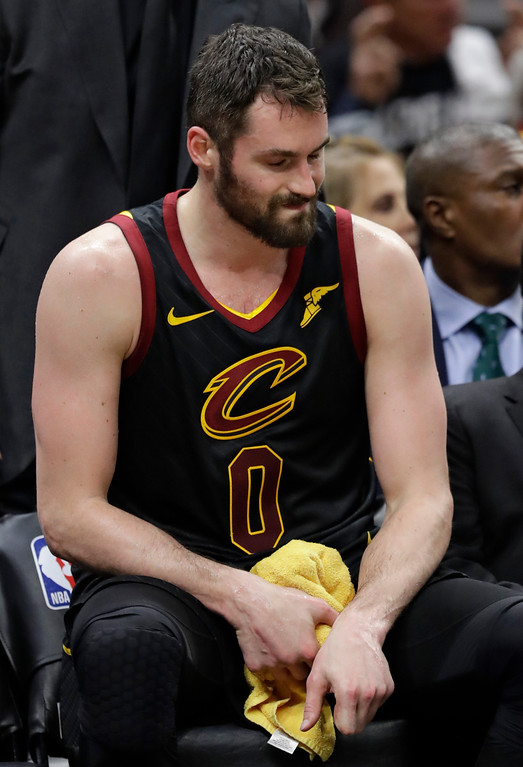 . Cleveland Cavaliers\' Kevin Love grimaces during the second half of Game 2 of the team\'s NBA basketball first-round playoff series against the Indiana Pacers, Wednesday, April 18, 2018, in Cleveland. Love scored 15 points, but the All-Star center injured his left hand, the same one he broke earlier this season, with 3:43 left. The Cavaliers won 100-97. (AP Photo/Tony Dejak)