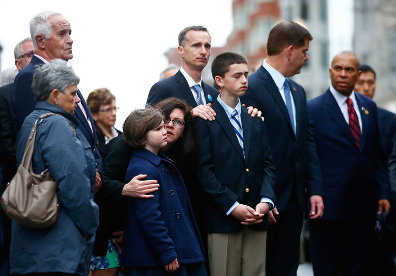 . The family of Martin Richard including Bill Richard and other members of the victims families stand during a wreath-laying ceremony commemorating the one-year anniversary of the Boston Marathon bombings on Boylston Street near the finish line on April 15, 2014 in Boston, Massachusetts. Last year, two pressure cooker bombs killed three and injured an estimated 264 others during the Boston marathon, on April 15, 2013.  (Photo by Jared Wickerham/Getty Images)