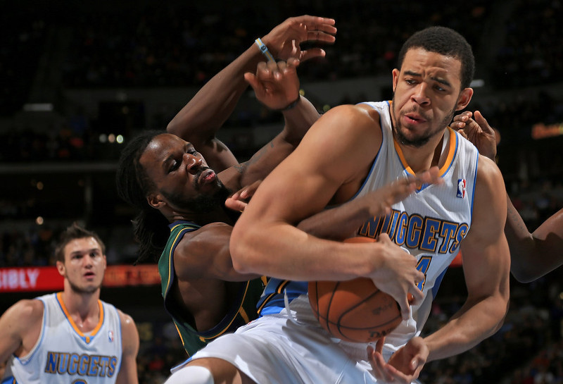 . JaVale McGee #34 of the Denver Nuggets grabs a rebound away from DeMarre Carroll #3 of the Utah Jazz at the Pepsi Center on January 5, 2013 in Denver, Colorado. The Nuggets defeated the Jazz 110-91.  (Photo by Doug Pensinger/Getty Images)