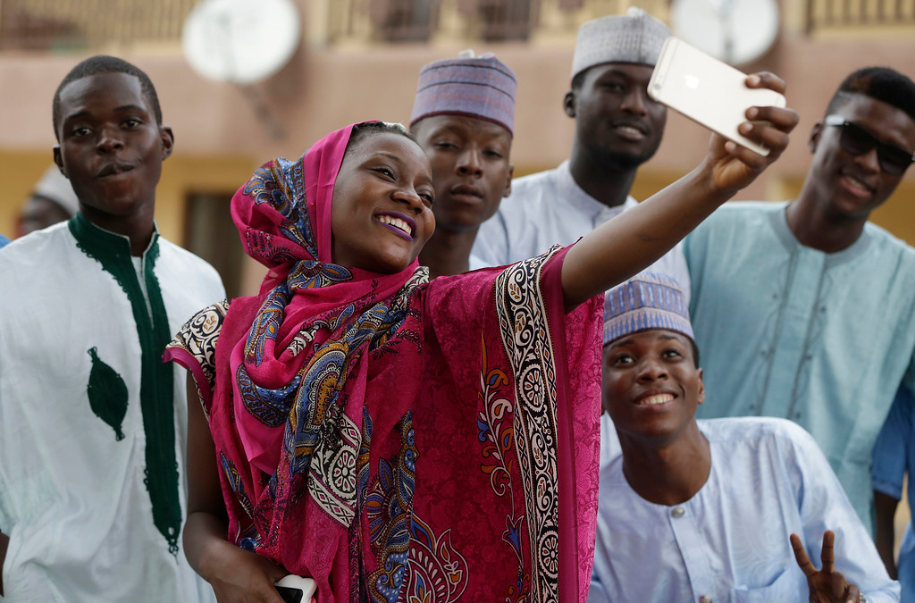 . A Nigeria Muslim wpman and friends takes a selfie photo after Eid al-Adha, or Feast of Sacrifice, that commemorates the Prophet Ibrahim\'s faith, at the prayer ground in Lagos, Nigeria, Monday, Sept. 12, 2016. Eid al-Adha marks the end of hajj. (AP Photo/Sunday Alamba)