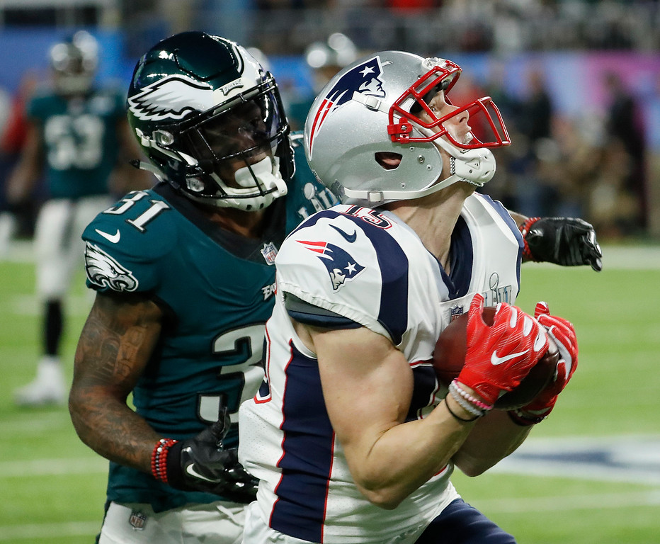 . New England Patriots\' Chris Hogan catches a pass in front of Philadelphia Eagles\' Jalen Mills during the first half of the NFL Super Bowl 52 football game Sunday, Feb. 4, 2018, in Minneapolis. (AP Photo/Matt York)