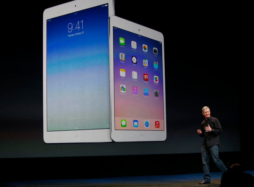 """. Apple CEO Tim Cook announced a release of new iPad models Tuesday morning, Oct. 22, 2013 in San Francisco, Calif., including the iPad Air, a thinner and lighter 10-inch tablet, and a new iPad Mini with a high-definition \""""Retina\"""" display.  (Karl Mondon/Bay Area News Group)"""
