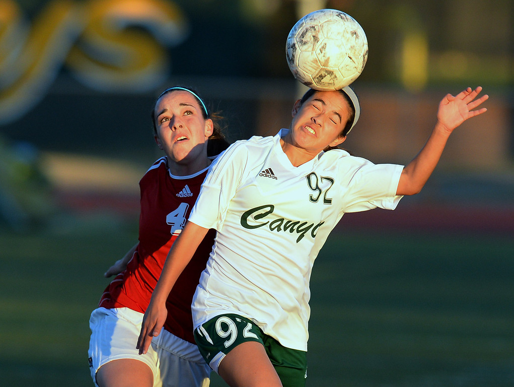 . Canyon\'s Vanessa Quintero #92 and Lancaster\'s Natalie Mitchell #4 battle for the ball during their girls soccer game at Canyon High School in Santa Clarita Thursday, January 9, 2014.  (Photo by Hans Gutknecht/Los Angeles Daily News)