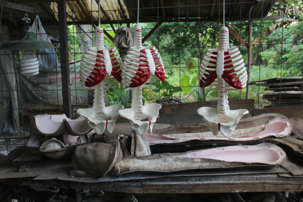 . A craftsman works on human body mannequins on April 23, 2014 in Depok, West Java, Indonesia. The mannequins are made from fiberglass and will be used in schools, hospitals and laboratories.  (Photo by Nurcholis Anhari Lubis/Getty Images)