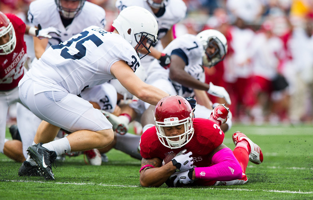 . Penn State\'s Pat Zerbe (35) downs Indiana\'s Cody Latimer (3) as he falls onto the ball after it was fumbled by Penn State on a kick-off return in the second half of an NCAA college football game, Saturday, Oct. 5, 2013, in Bloomington, Ind. Indiana defeated Penn State 44-24. (AP Photo/Doug McSchooler)