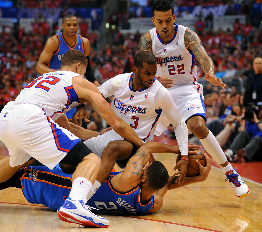 . Clippers, from left, Blake Griffin, Chris Paul and Matt Barnes converge on the Thunder\'s Thabo Sefolosha during a scramble for a loose ball, Friday, May 9, 2014, at Staples Center. (Photo by Michael Owen Baker/Los Angeles Daily News)