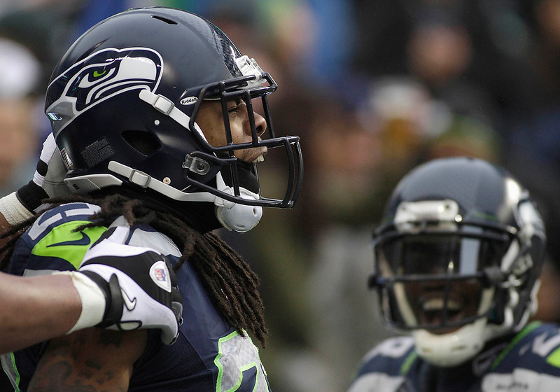 . Seattle Seahawks\' Richard Sherman celebrates his touchdown on an interception against the Arizona Cardinals during the second quarter of their NFL football game in Seattle, Washington, December 9, 2012. REUTERS/Robert Sorbo