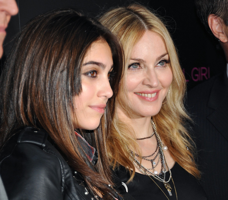 """. Pop singer Madonna, right, and her daughter Lourdes \""""Lola\"""" Leon Ciccone attend the launch of their \'Material Girl\' clothing line at Macy\'s Herald Square on Wednesday, Sept. 22, 2010 in New York. (AP Photo/Evan Agostini)"""
