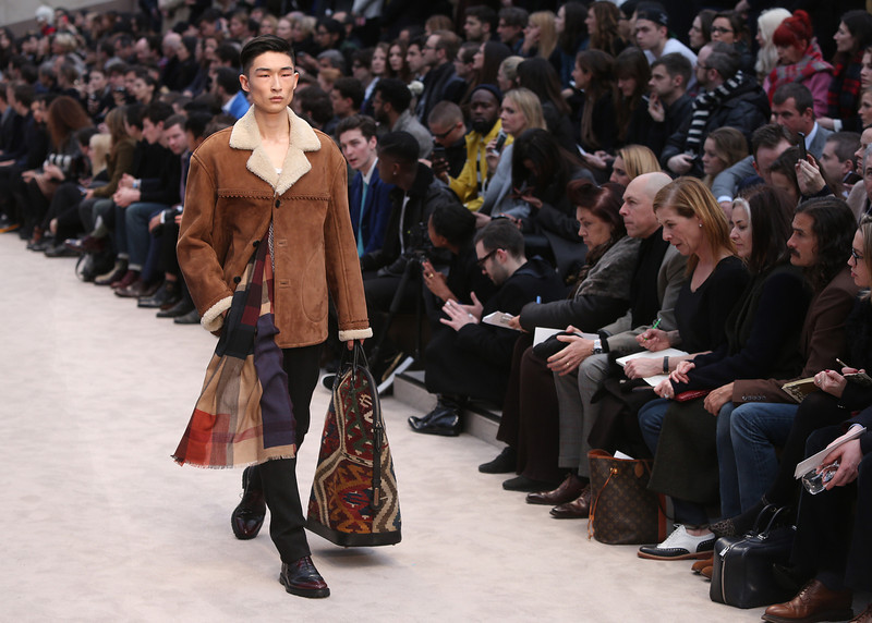 . A model wears a design created by Burberry Prorsum during London Collections for Men Autumn/Winter 2014 fashion show, at the Royal Albert Memorial in west London, Wednesday, Jan. 8, 2014. (Photo by Joel Ryan/Invision/AP)