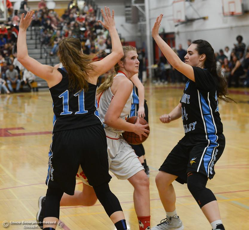 . Chico High\'s Adair Hotmer (11) goes up for a shot against Pleasant Valley\'s Olivia Layne (11) and Sierra Rosenbalm (24), Thursday, February 8, 2018, in Chico, California. (Carin Dorghalli -- Enterprise-Record)
